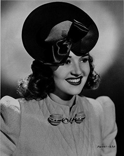 Posterazzi Poster Print Collection Betty Grable Portrait in Black Hat and White Pointed Sleeve Cotton Dress with Brooch Photo, (24 x 30), Multicolored