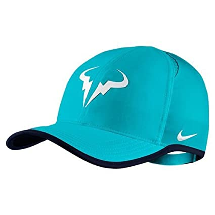 d3f10e9e101cb Amazon.com  Nike Rafa Premium Feather Light Adjustable Cap  Clothing
