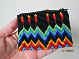 hand beaded glass seed beads. Fair trade Guatemalan handmade southwest design feathers native american rainbow geometric zig zag pattern. zippered coin purse credit card holder pouch bag