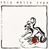 Hailing from the northern California town of Davis, Thin White Rope was unfathomably pegged as a proponent of the paisley underground movement. The songs the group covered over the course of their ten-year career is far more revealing: SUICIDE, THE S...