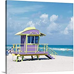 Gallery-Wrapped Canvas entitled 'Art Deco lifeguard stand on South Beach, Miami, FL'. Multiple sizes available. Primary colors within this image include: Dark Yellow, Black, White, Gray Blue. Made in USA. All products come with a 365 day work...