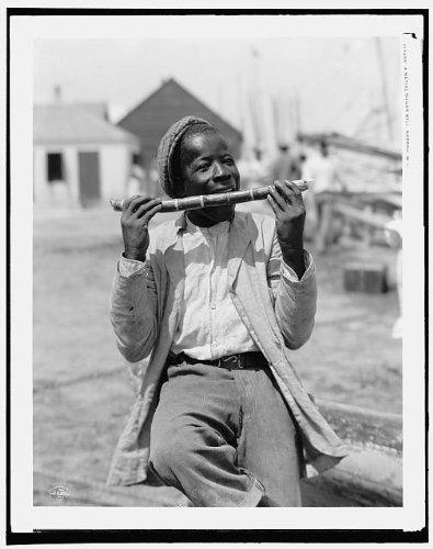 Photo: Native sugar mill, black children, eating, cane, Nassau, West Indies, Bahamas, c1901 . Size: