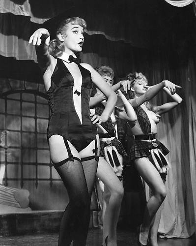 motional Photograph in stockings in burlesque scene on stage ()
