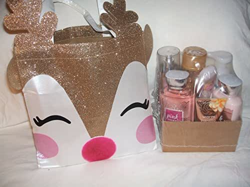 Bath & Body Works RAINDEER Special Tote gold white face glitter bag with gold raindeer & products are Champagne Toast body cream ., mist, pink Cashmere shower gel, body lotion,