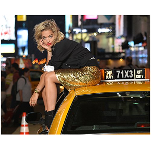 Cab Skirt - Rita Ora 8 Inch x10 Inch Photo Black Widow Gold Skirt Sitting on Roof of Yellow Cab kn
