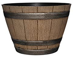 The classic whiskey barrel planter in a Distressed Oak finish with antique pewter colored bands. Lightweight & durable high density resin construction. Uv protected to prevent color from fading & delivered with drainage holes for outd...