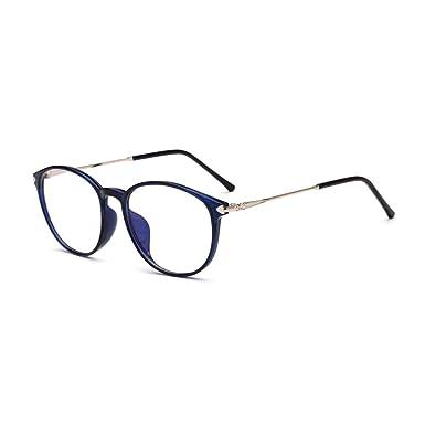 7d4d9d05b7 Amazon.com  TR90 Metal Round Eyeglasses Clear Lens Optical Glasses Frame  Women Men  Clothing