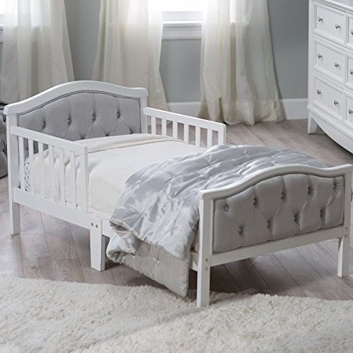 """Padded and upholstered head and footboard Upholstery is ultra-soft micro-fiber polyester Decorative """"crystal"""" Dimensions: 53L x 30W x 27H in white finish Fits a standard crib mattress"""