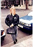 Vintage photo of Countess Serena Stanhope is wearing a pair of black jeans and a black bomb jacket with the symbol of Planet Hollywood. She wears a black leather bag.