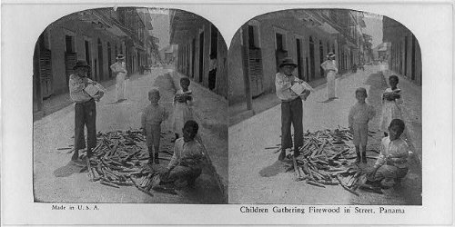 Photo: Children gathering firewood in street, Panama - In City Panama Shopping