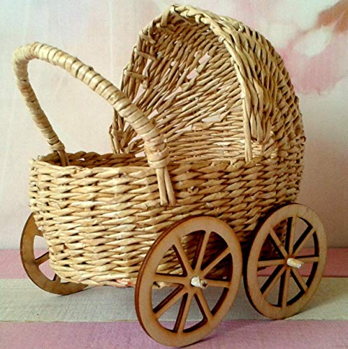 Miniature baby carriage, rattan look wicker doll stroller with wooden wheels. Handmade dollhouse pram