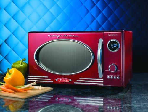 082677242211 - Nostalgia Electrics RMO400RED Retro Series .9 CF Microwave Oven, Red carousel main 1