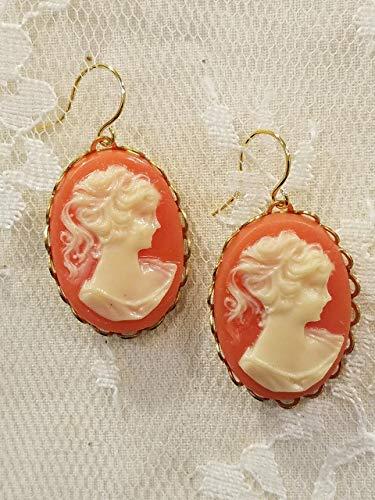 - Carnelian Background Goldtone Cameo Earrings with Dangles