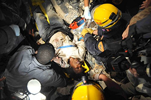 Home Comforts Laminated Poster Members of The Los Angeles County Fire Department Search and Rescue Team Rescue a Haitian Woman from Vivid Imagery Poster Print 24 x 36