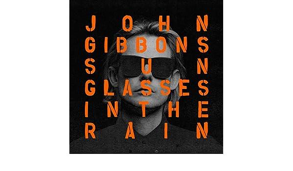 69fe4a2e8355 Sunglasses in the Rain (Radio Edit) by John Gibbons feat. Ai on Amazon Music  - Amazon.com