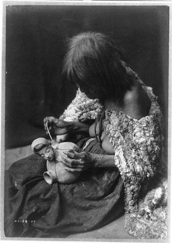 Photo: Mohave potter, old woman, rabbit skin blanket, yucca stem brush, pottery, Arizona, AZ . Size: