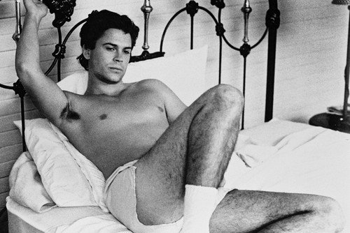 Rob Lowe in Masquerade 24x36 Poster beefcake bare chest in shorts lying on bed