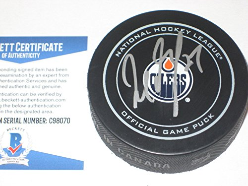Milan Lucic Signed Official Edmonton Oilers Game Puck with - Beckett Certified ()