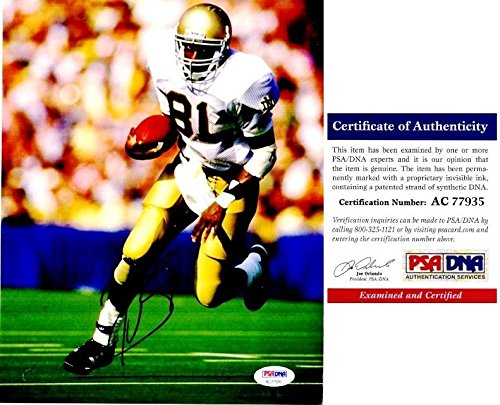 (Signed Tim Brown Photo - 8x10 inch 1987 Heisman Trophy Winner Certificate of Authenticity COA) - PSA/DNA Certified)