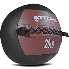 Our wall balls are great for working out your core, burning calories, and developing muscular endurance! This ball is black with a brown top, and weighs 20 lb. Throw them against the wall to hit a target, hitting multiple joints and muscle gr...