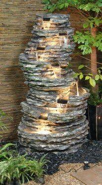 Cascada Efecto Roca de 8 Niveles y con Luces: Amazon.es: Jardín