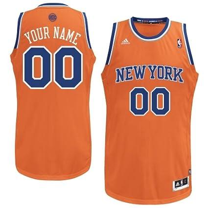 aff7e585e09 Amazon.com : adidas New York Knicks Custom Swingman Alternate Jersey -  Orange : Sports & Outdoors