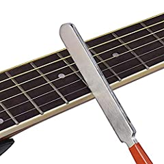 Features:The file is used for narrow fret crowning after leveling. With ergonomic handle for comfortable holding.The leveling tool with accurate straight edges helps you to detect any discrepancy existing in frets height.Fret protector shims ...