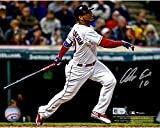 "This 8"" x 10"" photograph has been personally hand-signed by Edwin Encarnacion. It has been obtained under the auspices of the MLB Authentication Program and can be verified by its numbered hologram at MLB It also comes with an individually nu..."