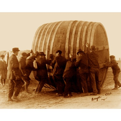 Quality digital print of a vintage photograph - Rolling a vat of beer - Oregon, 1920.. Sepia Tone 11x14 inches - Luster ()