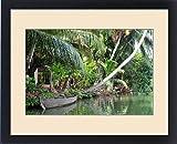 Framed Print of Asia, India, Kerala (Backwaters). A boat lays along a Kerala canal shoreline