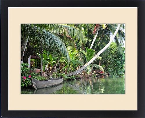 Framed Print of Asia, India, Kerala (Backwaters). A boat lays along a Kerala canal shoreline by Fine Art Storehouse