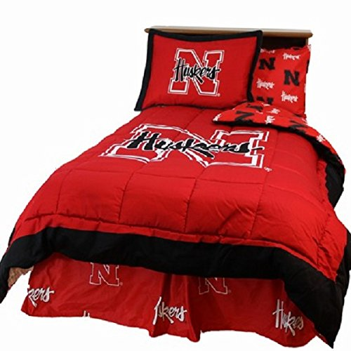 Nebraska Cornhuskers (5) Piece QUEEN Size Reversible Comforter Set - Set Includes: (1) QUEEN Size Comforter, (2) Shams and (2) Standard Size Solid Color ()