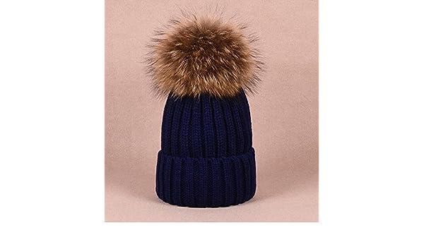 Amazon.com  Fuzzy Pom Pom Beanie Knitted Hats Real Puffs Ball Beanies  Fluffy Puffs Ball Kids Women s Hats Handmade Navy Fluffy Hats   Beanies   Handmade 95179976b66e
