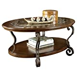 Ashley Furniture Signature Design – Nestor Glass Top Coffee Table – Cocktail Height – Oval – Medium Brown For Sale