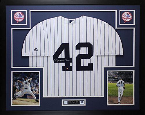 Mariano Rivera Autographed Pinstriped Yankees Jersey - Beautifully Matted and Framed - Hand Signed By Mariano Rivera and Certified Authentic by Steiner COA - Includes Certificate of -