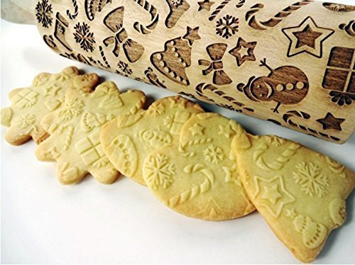 - CHRISTMAS GIFTS embossing rolling pin. Embossing rolling pin with Christmas symbols. Christmas gingerbread cookies.