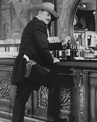 The Shootist John Wayne iconic pose at saloon bar whisky