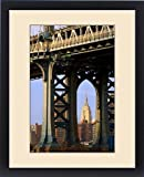 Framed Print of The Empire State Building viewed through a tower of the Manhattan Bridge, New