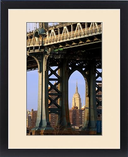 Framed Print of The Empire State Building viewed through a tower of the Manhattan Bridge, New by Fine Art Storehouse