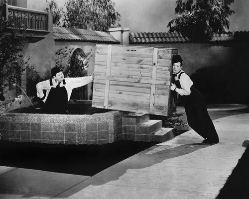 Laurel and Hardy's Laughing 20's classic of the boys The Music Box moving a piano 8x10 Promotional Photograph