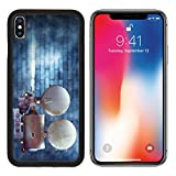MSD Premium Apple iPhone X Aluminum Backplate Bumper Snap Case Vintage cinema film projector against a wall IMAGE 24094448