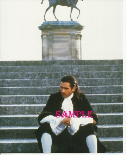 The Highlander Adrian Paul Sitting in Front of Statue in Colonial type clothes Photo 8x10 HI1020]()