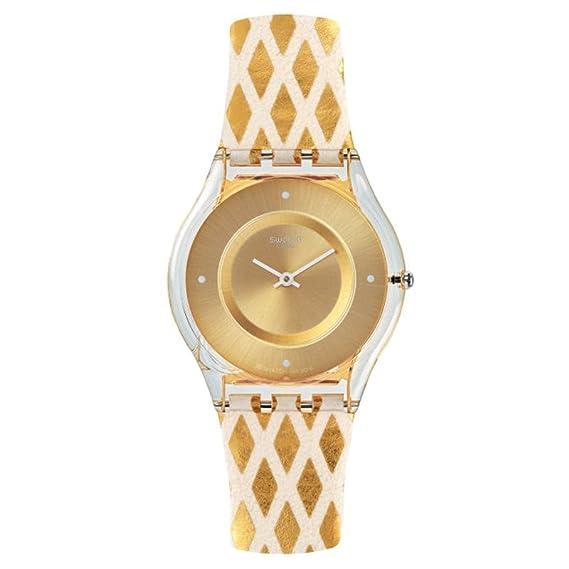 Swatch de la mujer Classic sfe103 gamuza de oro reloj de cuarzo: Swatch: Amazon.es: Relojes