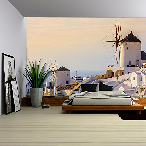 Famous view of Oia village at the Island Santorini Greece in sunset rays