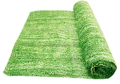 A roll of artificial grass looking fresh and realistic.
