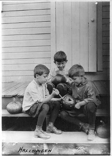 HistoricalFindings Photo: Halloween,3 boys on porch steps carving pumpkins,c1917 ()