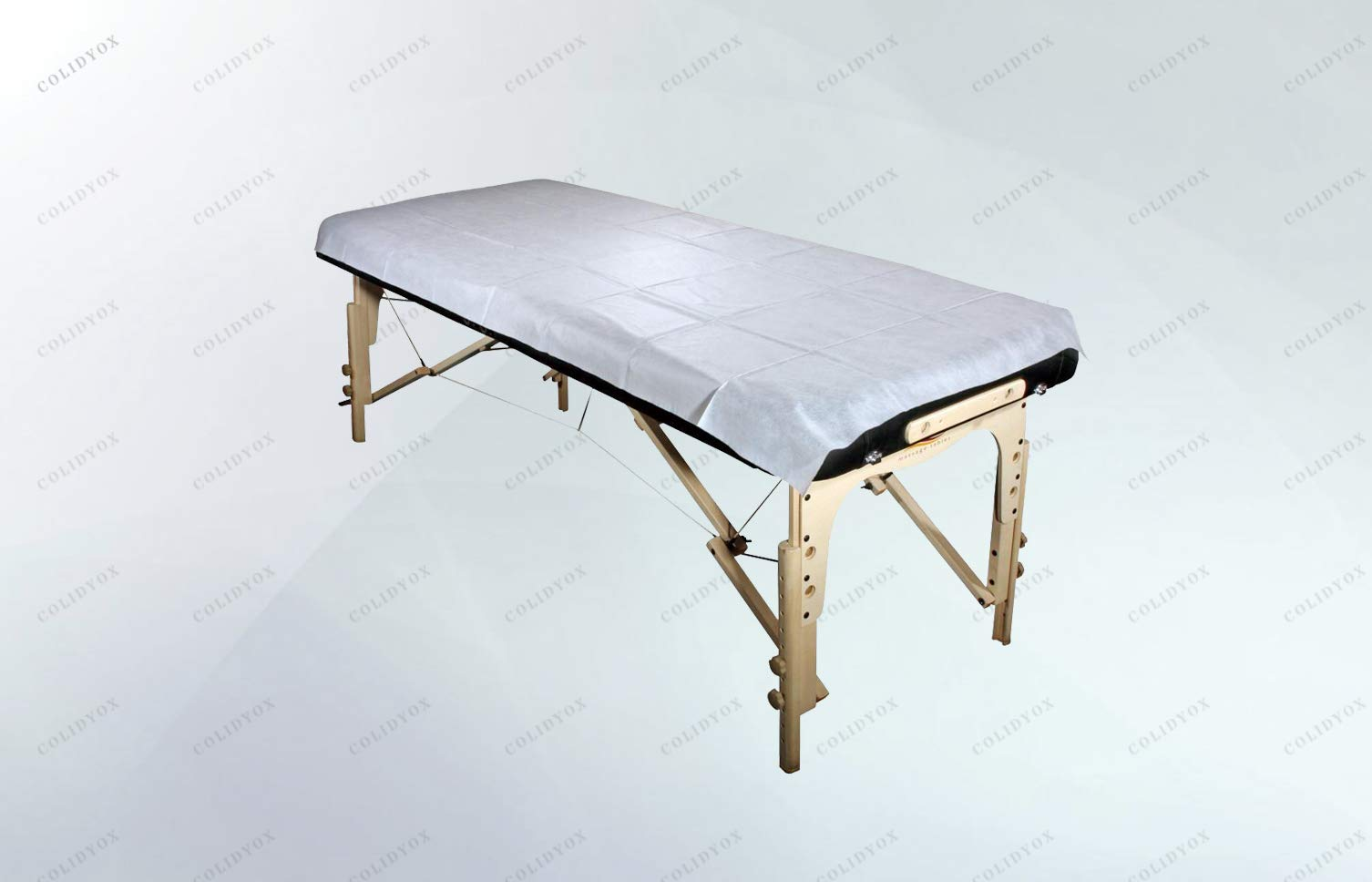 COLIDYOX_Unnecessary laundry,disposable sheets,well suited for event work, Spas, Tattoo Shops, or Medical treatments,thin poly backing to protect tables from moisture, oil and sweat