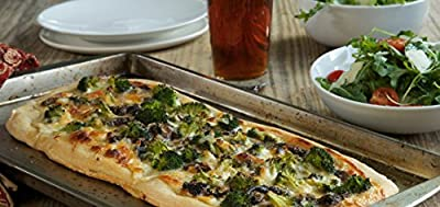 Chef'd White Pizza with Broccoli and Mushrooms with Arugula Salad and Lemon Mint Vinaigrette by partner Vegetarian Times