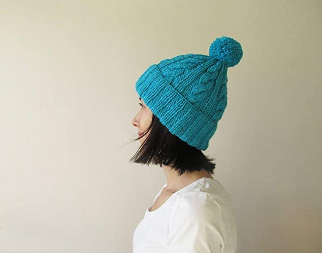d8dff6767ad8e Amazon.com  Cable Knit Hat in Turquoise