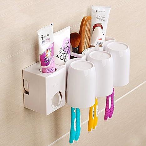 Innovativa a ventosa estante del cepillo de dientes taza juego de tres Menta Pincel Porta cepillo pared: Amazon.es: Hogar